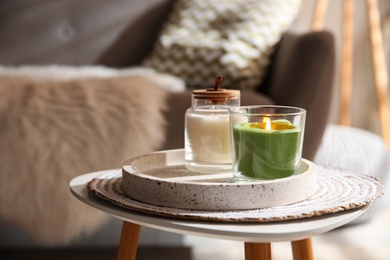 Aroma candles on small table indoors. Interior design