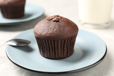 Delicious cupcake with chocolate crumbles on grey table, closeup