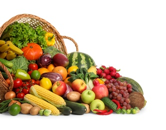 Assortment of fresh organic fruits and vegetables on white background
