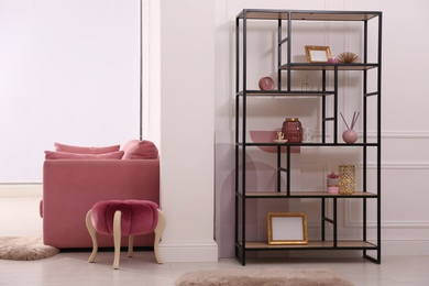 Stylish living room interior with comfortable furniture and shelving unit. Modern design