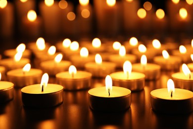 Many burning candles on table. Memory day