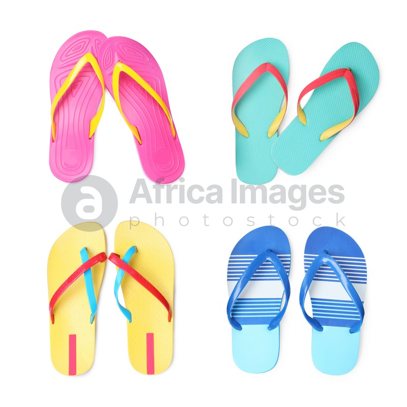 Set with different flip flops on white background, top view