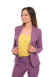 Portrait of beautiful young woman in business suit on white background