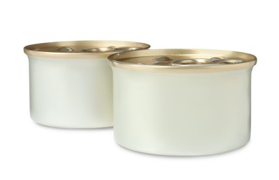 Tin cans of wet pet food on white background