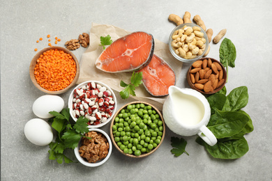 Products rich in protein on light table, flat lay