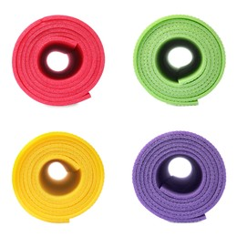 Set with colorful rolled camping mats on white background