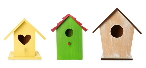 Set with different beautiful bird houses on white background, banner design