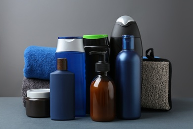 Set with men's personal hygiene products on grey table