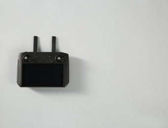 New modern drone controller on light background, top view