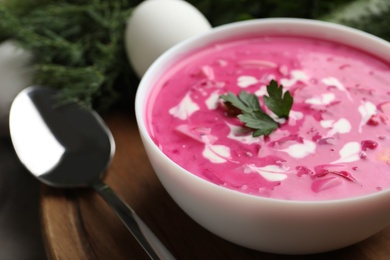 Delicious cold summer beet soup on wooden board, closeup