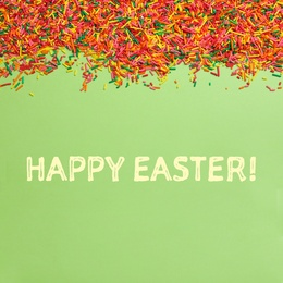 Text Happy Easter and colorful sprinkles on green background, flat lay. Confectionery decor