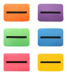 Set with colorful foam tourist seat mats on white background, top view
