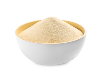 Uncooked organic semolina in bowl isolated on white