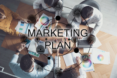 Digital marketing plan. People working at table, top view