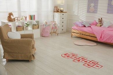 Red hopscotch floor sticker in bedroom at home