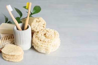 Composition with natural loofah sponges on table. Space for text
