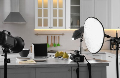 Professional equipment and many pears on table in kitchen. Food photo