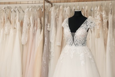 Beautiful wedding dress on mannequin in boutique