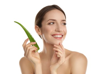 Happy young woman with aloe leaf on white background