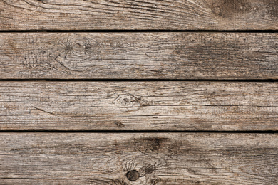 Textured wooden surface as background, closeup view