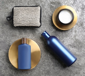 Flat lay composition with men's cosmetics on grey stone background