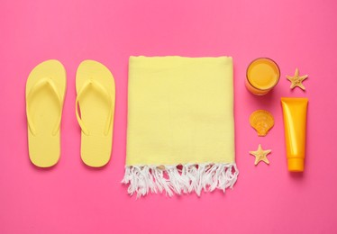 Flat lay composition with different beach objects on pink background
