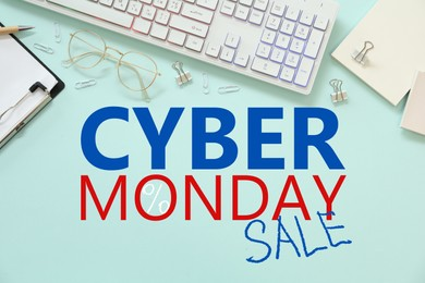Cyber Monday Sale. Modern keyboard and stationery on turquoise background, flat lay