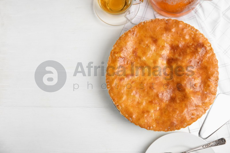 Delicious pie with meat on white wooden table, flat lay. Space for text