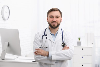 Portrait of pediatrician with stethoscope in clinic