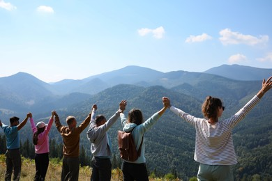 Group of people spending time together in mountains