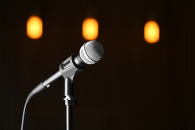 Microphone against festive lights, space for text