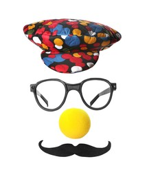 Funny clown's face made of hat, eyeglasses, foam nose and mustache on white background