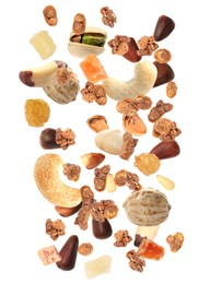 Delicious granola, nuts and dried fruits falling on white background. Healthy snack