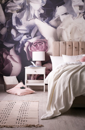 Stylish floral room interior with comfortable bed
