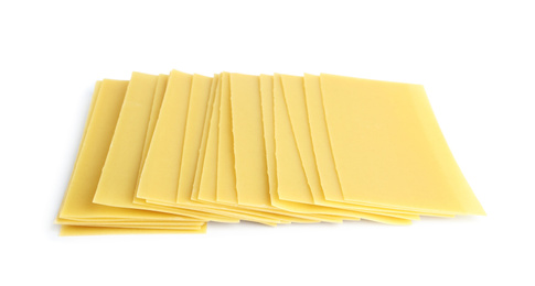 Uncooked lasagna sheets on white background. Italian cuisine