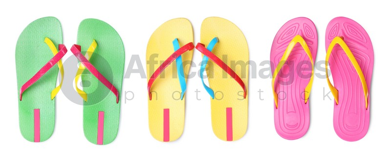 Set with different colorful flip flops on white background, top view. Banner design