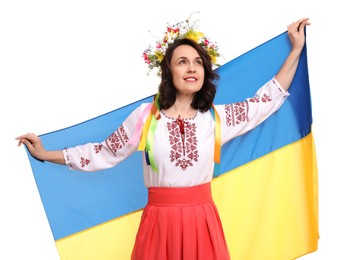 Happy woman in national clothes with flag of Ukraine on white background