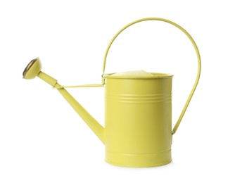 Yellow metal watering can isolated on white