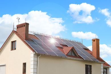 Building with installed solar panels on roof. Alternative energy source