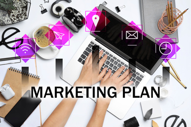 Digital marketing plan. Woman working with laptop at table, top view