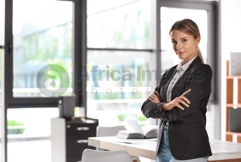 Portrait of female business trainer in office wear at workplace