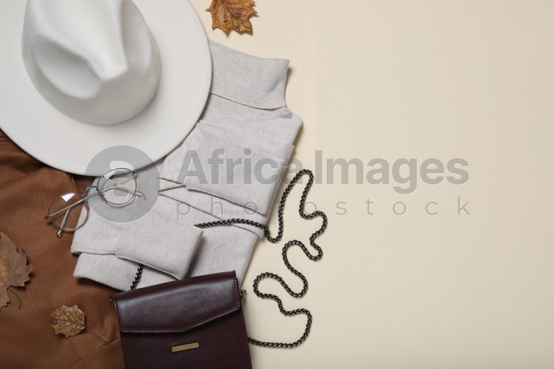 Flat lay composition with stylish hat and clothes on beige background, space for text