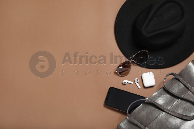 Flat lay composition with stylish hat on brown  background, space for text
