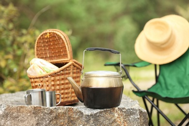 Set of camping equipment on rock outdoors