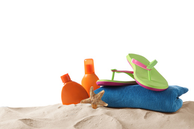 Composition with beach objects on sand against white background