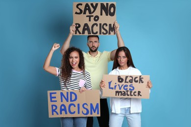 Protesters demonstrating different anti racism slogans on light blue background. People holding signs with phrases