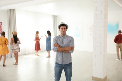 Thoughtful man at exhibition in art gallery