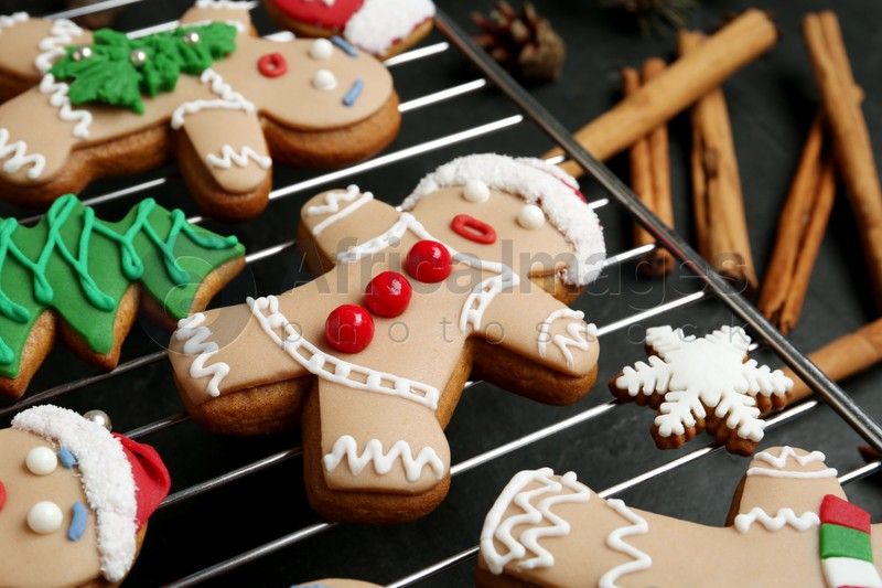 Delicious Christmas cookies on black table, closeup