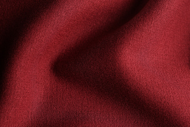 Texture of beautiful red fabric as background, closeup