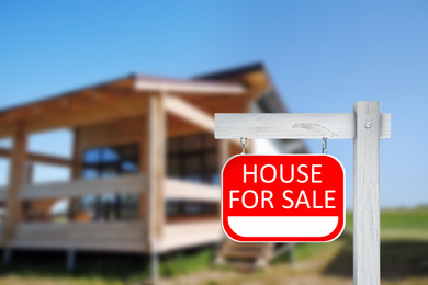 Red real estate sign with inscription HOUSE FOR SALE outdoors on sunny day, space for text